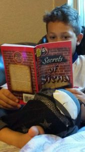 child_reading_secrets